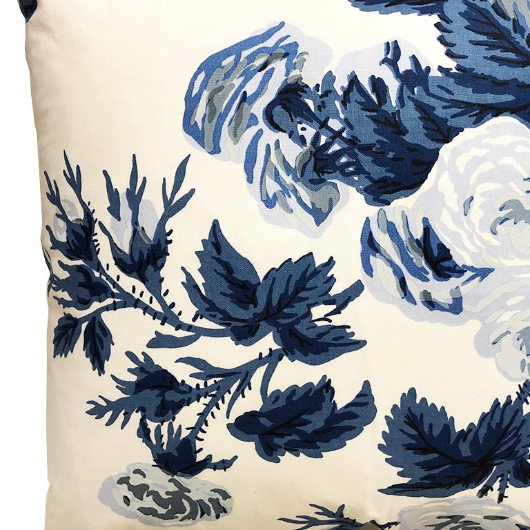 One down filled pillow in a fabric by Schumacher in a blue Pyne Hollyhock. Beautiful traditional chinz chinoiserie blue floral pattern. Due to fabric repeat, each pillow varies. Fabric is on both sides and features comfy down filling, knife edge and