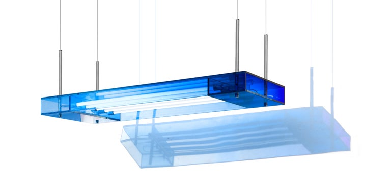 This square hanging light is made with compound glass in blue color. Size and color are customizable upon request. Light specification: T8 9Wx6  Studio Buzao is an experimental design studio. It tempts to breakthrough the difference between