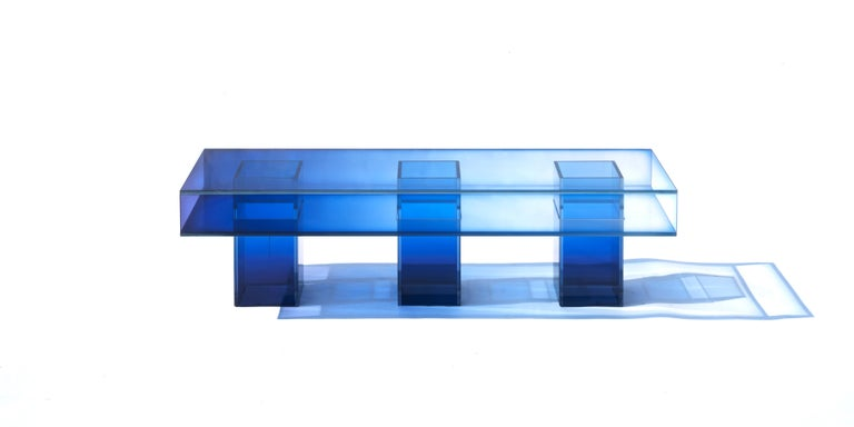 This long square bench is made with compound glass in blue color. Size and color are customizable upon request.   Studio Buzao is an experimental design studio. It tempts to breakthrough the difference between product and artwork by immersing the