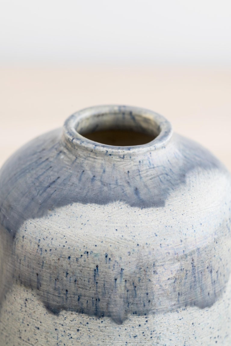 Earthenware vase with shades of blue glaze by Annikki Hovisaari  Incised with artist's initials AH and dated 1935  Light scratches but overall fine condition.