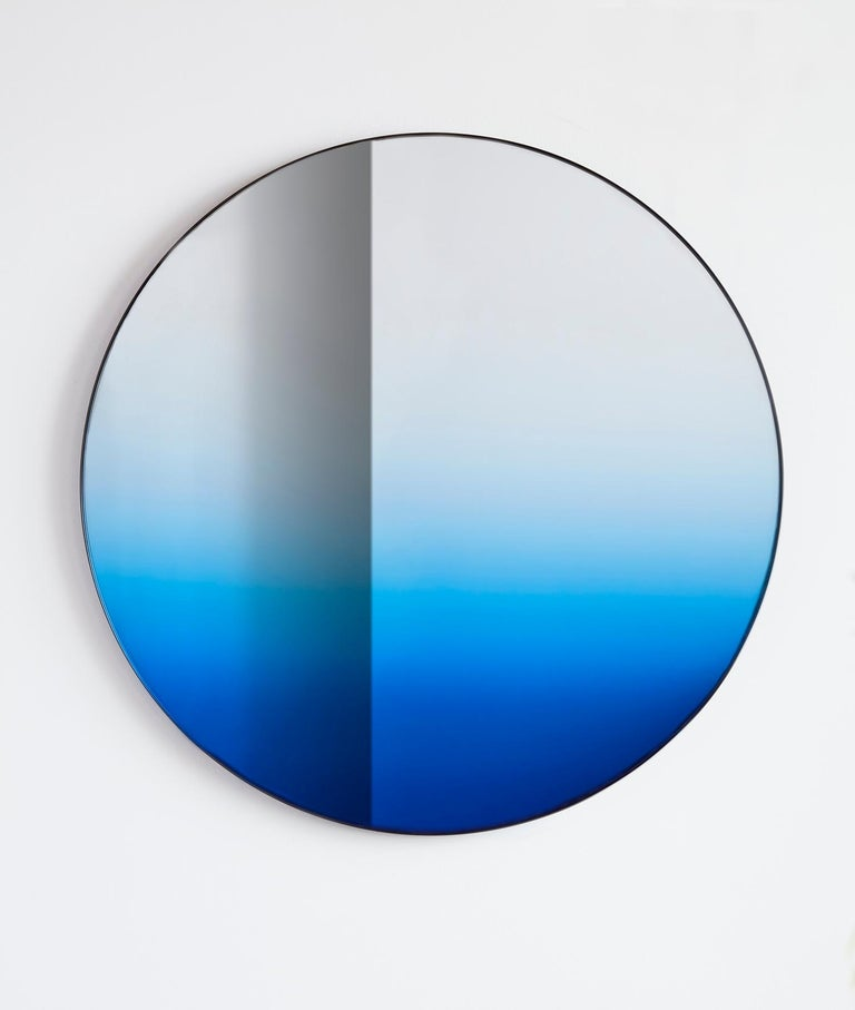 Inspired by the shifting colors of the sky, the Gradient mirror is a Minimalist design that integrates color to create an atmospheric effect of the environment it reflects. Utilizing the latest in glass manufacturing technology, the mirror's color