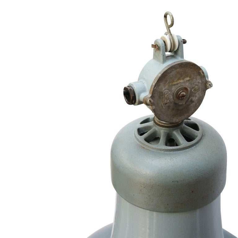 Enamel industrial pendant Blue grey enamel shade, cast iron top, white inside.  Weight: 4.70 kg / 10.4 lb  Priced per individual item. All lamps have been made suitable by international standards for incandescent light bulbs, energy-efficient