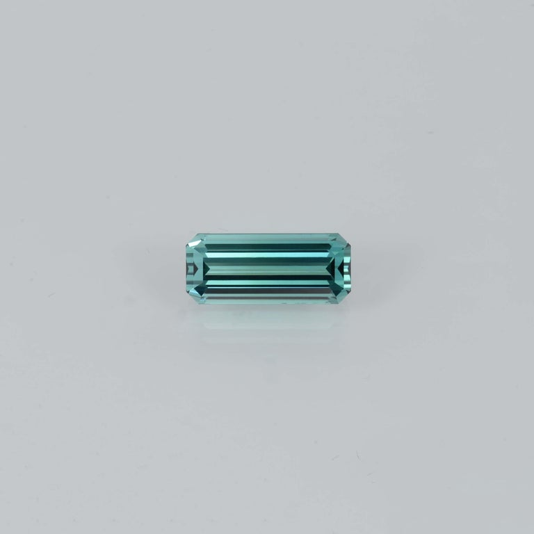Very special 5.85 carats, bluish Green Tourmaline, elongated, rectangular octagon gem, offered loose to a discerning gem collector. Returns are accepted and paid by us within 7 days of delivery. We offer supreme custom jewelry work upon request.
