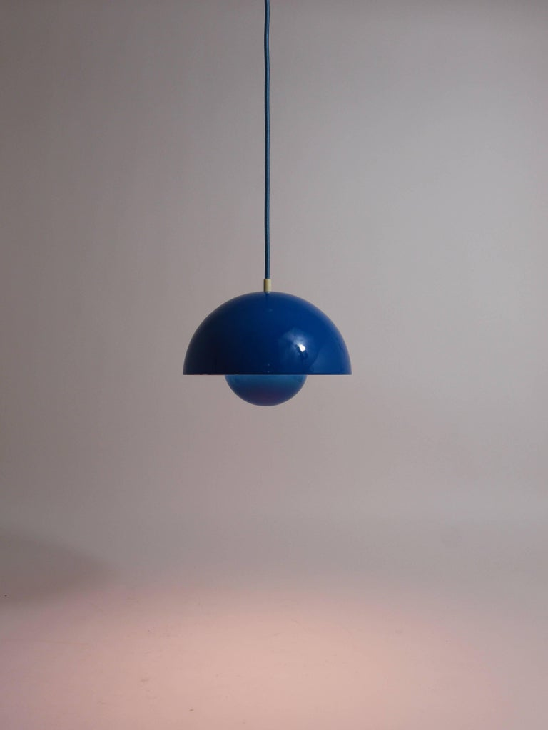 An iconic petrol-blue flowerpot pendant light, designed in 1969 by Verner Panton for Louis Pulsen, Denmark. Rare blueish-green color, appears more green than on the images. A simple but beautiful ceiling light, consisting of two enameled
