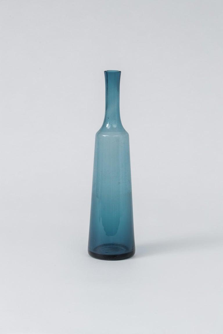 Handsome blue bottle by Holmegaard of Denmark.