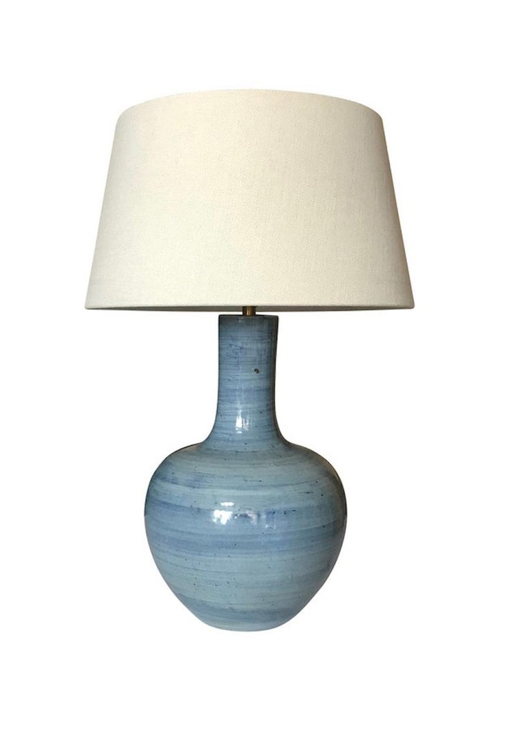 Contemporary pair of large blue terra cotta thin neck lamps with horizontal brush design. New Belgian linen shade. Measures: Overall height including shade 31
