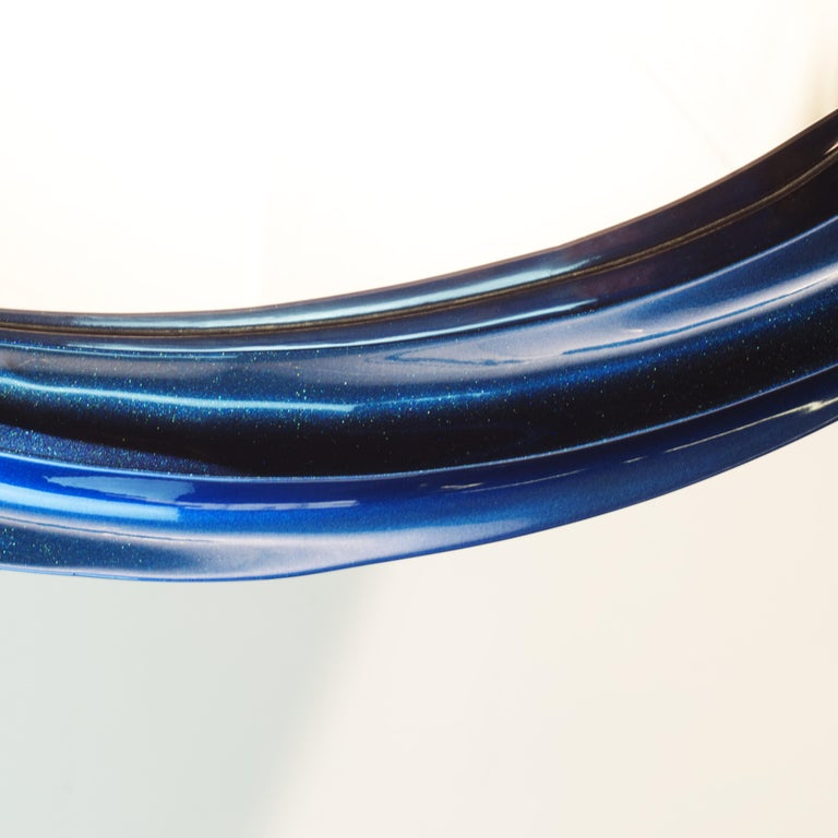 Wave II series mirror is finished in brilliant blue pearlescent lacquer. Additional layering of Jade particles creates mild color shifting effect. The intensity of the radiance varies with the illuminating light. All Wave II objects are crafted in