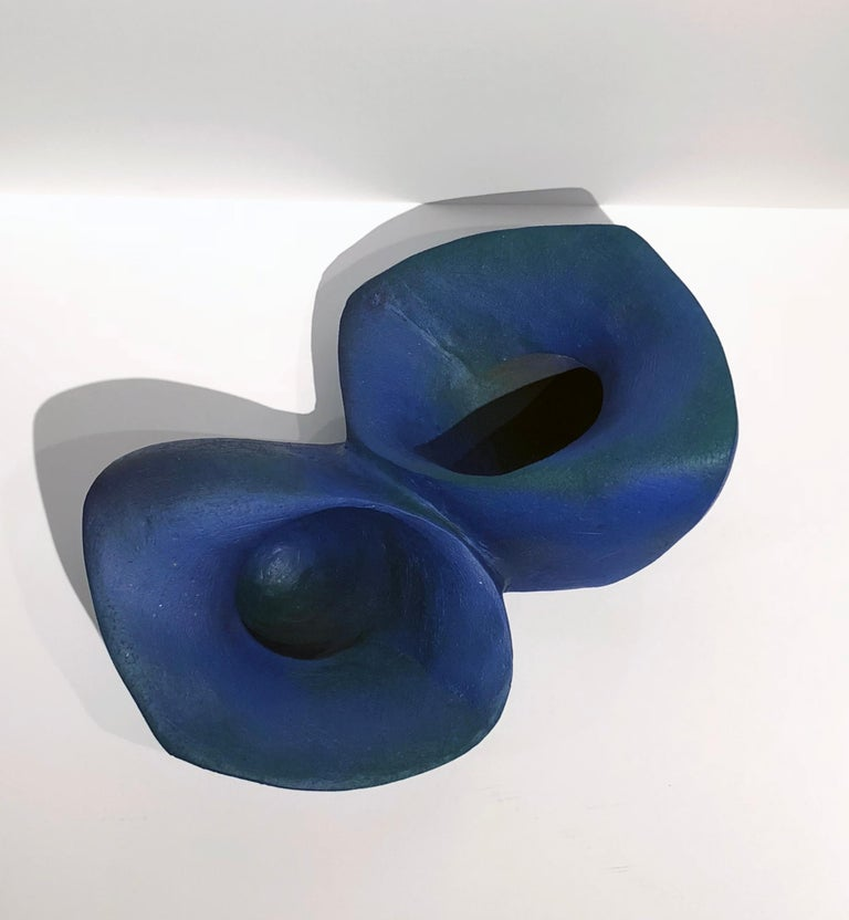 This vivid blue vessel is totally built by hand and kiln fired.  The clay is glazed in cobalt blue and the surface is textured with variation throughout.    Jerilyn Virden Blue Join Handbuilt earthenware, hollow construction, glazed &
