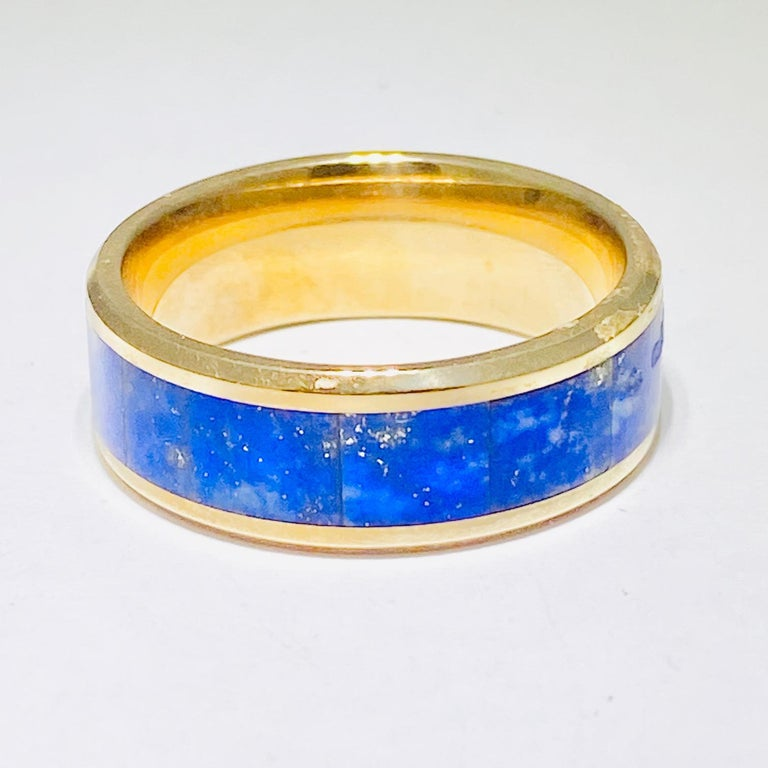 This blue lapis lazuli band ring is vibrant and stunning!! The blue in the ring pops against the bright gold!! This band is easy to wear and extremely comfortable! This band would work as an every day band or a going out band. This ring is super