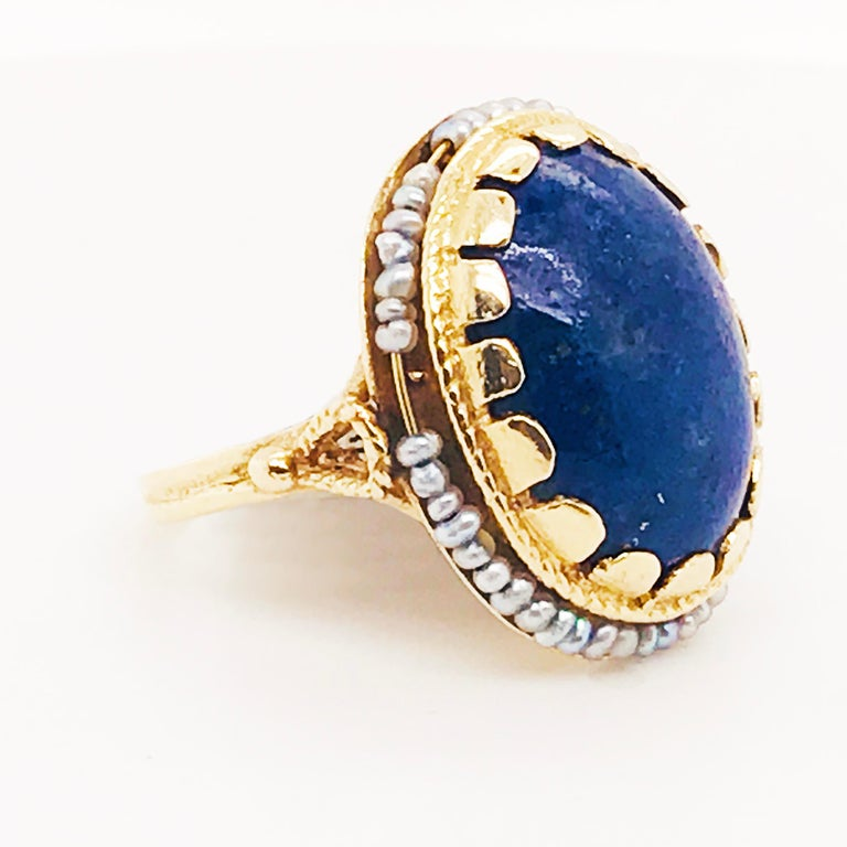Artisan Blue Lapis and Seed Pearl Halo Estate Ring 14 Karat Yellow Gold, circa 1960 For Sale