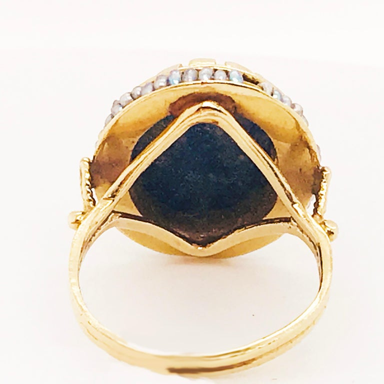 Oval Cut Blue Lapis and Seed Pearl Halo Estate Ring 14 Karat Yellow Gold, circa 1960 For Sale
