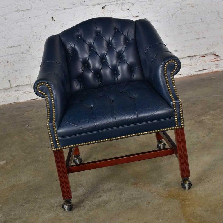 Blue Leather Rolling Captain's Chair Campaign Chippendale Style In Good Condition For Sale In Topeka, KS