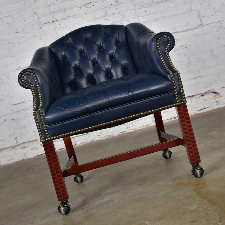 20th Century Blue Leather Rolling Captain's Chair Campaign Chippendale Style For Sale