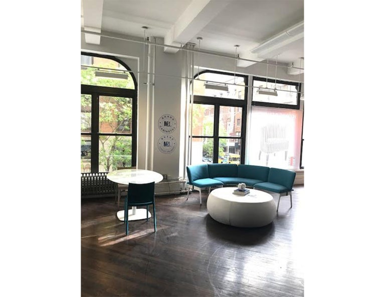 Mega bench Configuration with back. Upholstered in cat. 3 Jet #468 Cielo Legs: white painted consisting of the following: Armless seat with curved back, left Corner with back Armless seat with curved back, right Original price: $4,117.