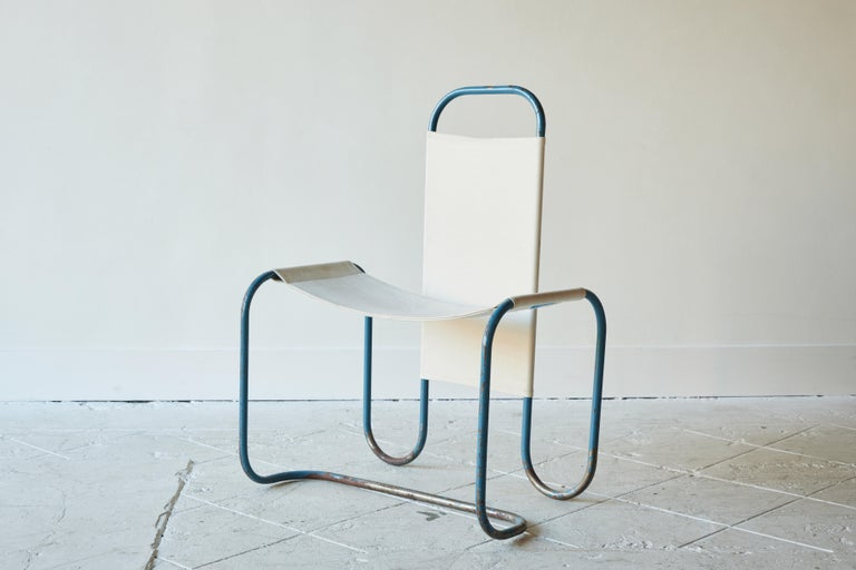 Painted blue metal Bauhaus sling chair with new canvas upholstery.
