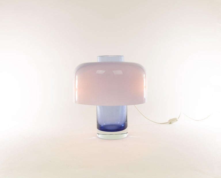 Blue Murano glass table lampLT 226designed by Carlo Nason and manufactured in the 1960s by Murano glassmaker A.V. Mazzega.  The blue base of the lamp can, as described in A.V. Mazzega, Catalogue No. 9, also be used as a vase.  The condition of