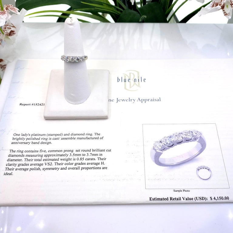 Blue Nile Anniversary Diamond Band Ring Style:  5-Stone  Metal:  Platinum Size:  6.25 - sizable Measurements:  3.5 MM to 3.7 MM TCW:  0.85 tcw Main Diamond:  5 Round Brilliant Diamonds Color & Clarity:  H - VS2  Hallmark:  PT Includes:  Blue Nile