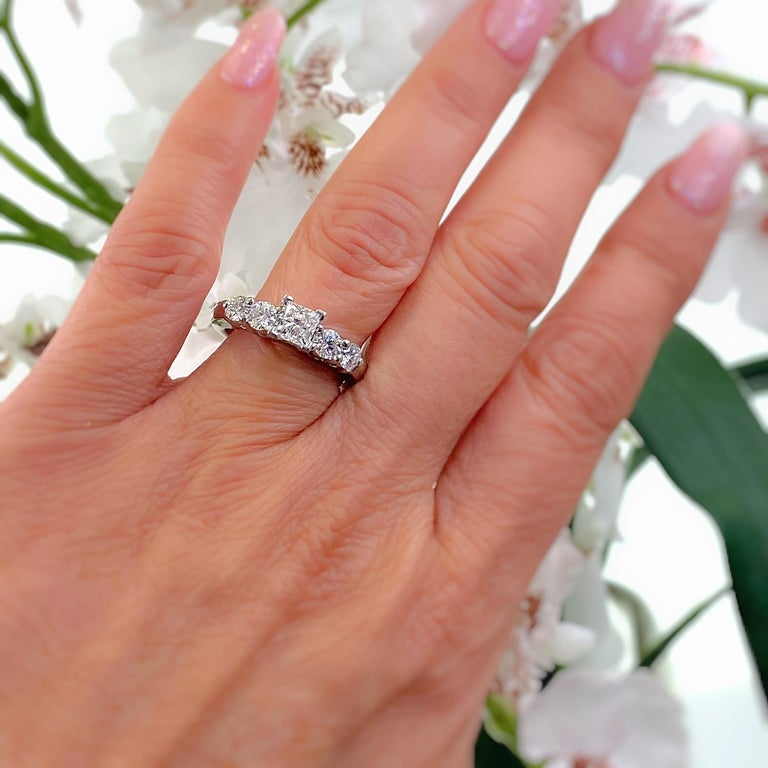 Blue Nile Diamond Engagement Ring Style:  Solitaire with Accents AGS Diamond Grading Report:  #7438305 Metal:  Platinum Size:  6.5 - sizable TCW:  1.36 tcw Main Diamond:  Princess Diamond 0.70 cts Color & Clarity:  G - VS1 Accent Diamonds:  4 Round