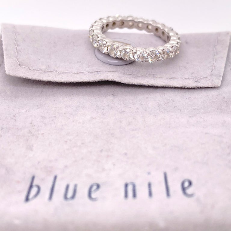 Blue Nile Diamond Eternity Band Style:  Full Circle Ref. number:  #1264788 Metal:  Platinum Size:  5.5  Measurements:  2.8 MM TCW:  2.07 tcw Main Diamond:  22 Round Brilliant Diamonds Color & Clarity:  H - VS2  Hallmark:  SDIL PT950 Includes:  BLUE
