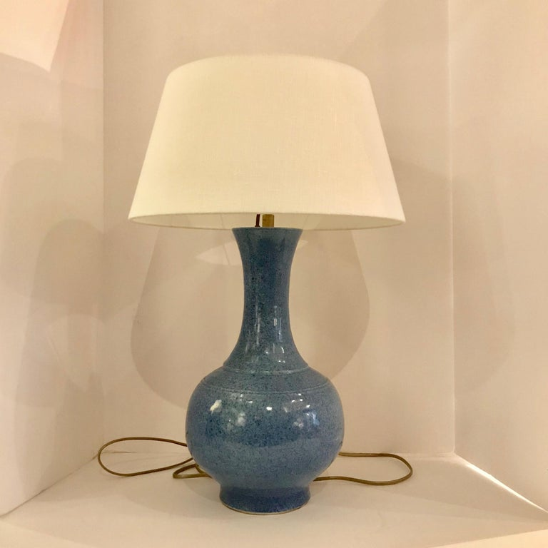 Contemporary Chinese pair mottled blue curved thin neck with round base lamps. New Belgian linen shade. Measures: Overall height including shade 22