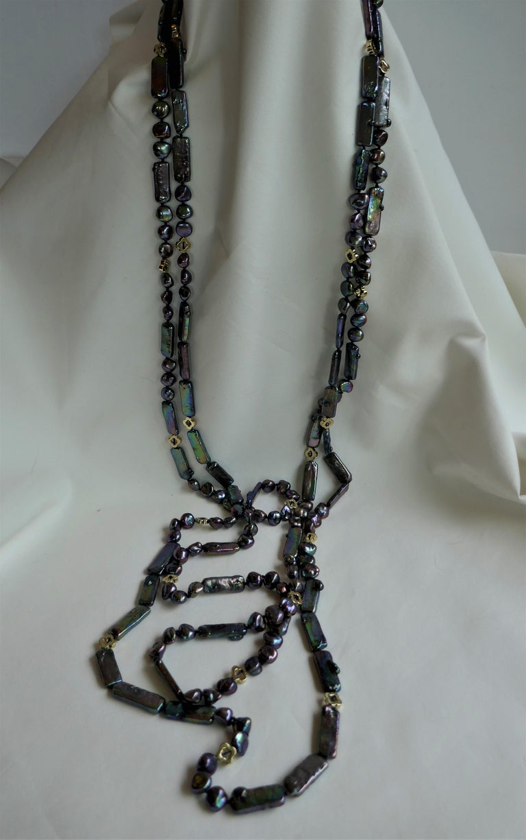 The photos do not capture the true color of these pearls. The color of the pearls are a  peacock blue and very wearable with many color tones.  I combined keshi nugget pearls and oblong cultured pearl with gold plated hematite to create this