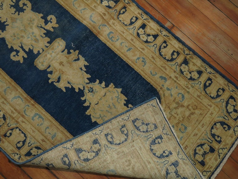 A narrow size Persian runner. In lovely blues and gold.