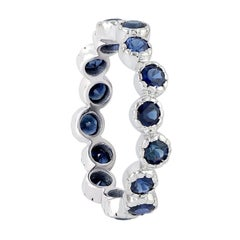 Blue Sapphire 18 Karat Gold Eternity Ring