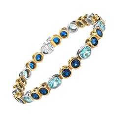 Blue Sapphire and Aquamarine 18 Karat Yellow and White Gold Bracelet