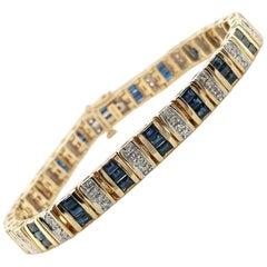 Blue Sapphire and Diamond 14 Karat Yellow Gold Bracelet