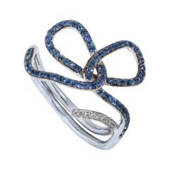"""Blue Sapphire and Diamond Contemporary White Gold """"Ribbon"""" Ring"""