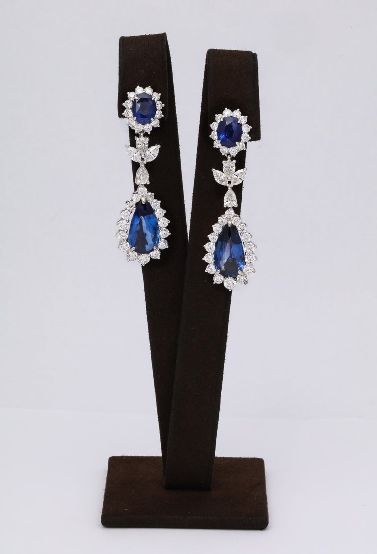 Blue Sapphire Drop Earrings   21.40 carats of vibrant Ceylon Blue Sapphires surrounded by 7.27 carats of white pear, marquise and round brilliant cut diamonds.   The pear shape drops weigh 15.03 carats and are GRS certified.  The earrings measure