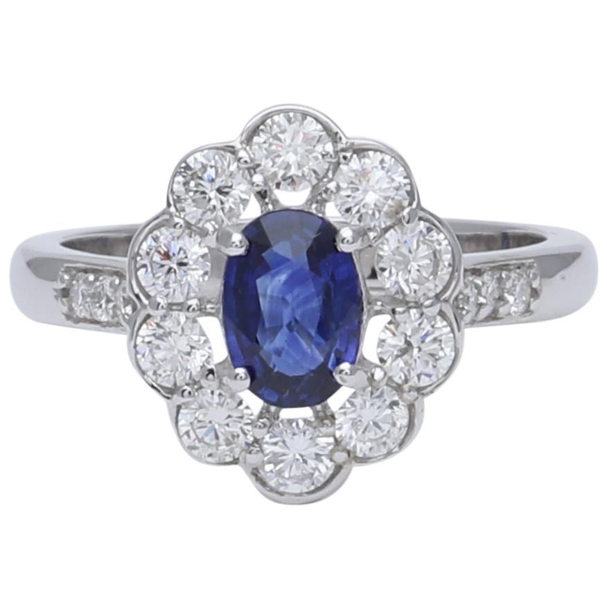 Blue Sapphire and Diamond Engagement Ring in 18 Karat White Gold