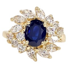 Blue Sapphire and Diamond Fancy Halo 14 Karat Yellow Gold Ring