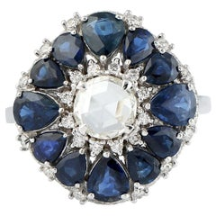 Blue Sapphire and Diamond Floral Ring in 18 Karat White Gold
