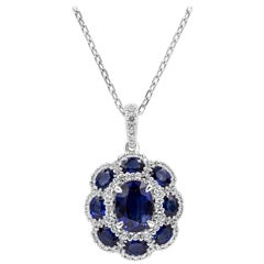 Blue Sapphire and Diamond Flower Pendant Necklace