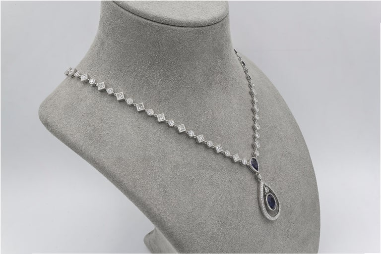 Women's Blue Sapphire and Diamond Halo Drop Necklace For Sale