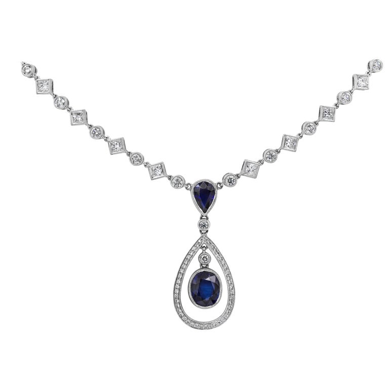Blue Sapphire and Diamond Halo Drop Necklace For Sale