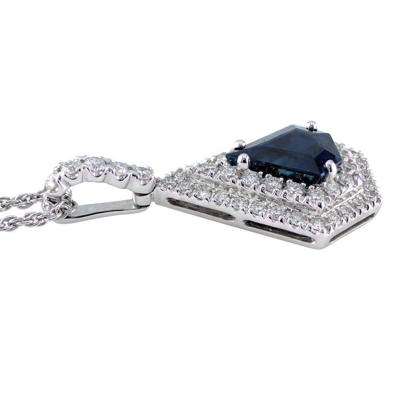 1.76 carat Kite-Shape Sapphire pendant, surrounded by 0.62 carat round diamonds, set in 18K.  Elegant pendant, that is sure to be an eye catching accessory to set a fun and classy mood at any occasion.   18 inch long chain.