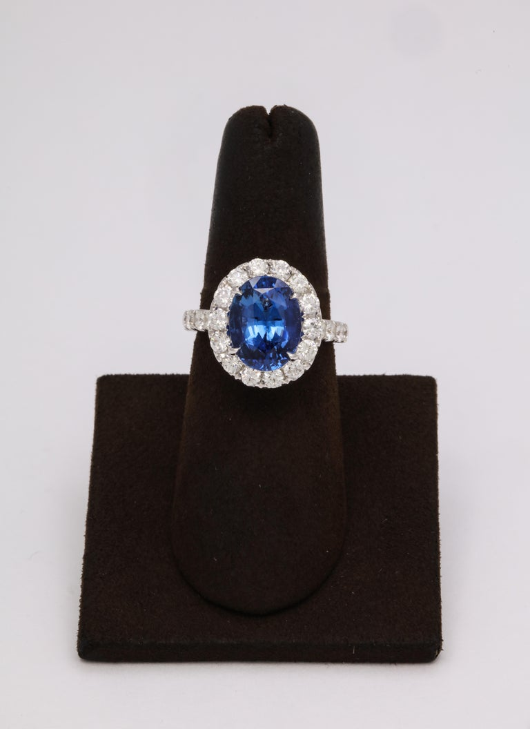 Beautiful Ceylon Sapphire!!  5.20 carat vibrant blue sapphire -- full of life!   Set in a wearable diamond mounting.   1.64 carats of white round brilliant cut diamonds.  The mounting features unique diamond detail and engraving.  Currently a size