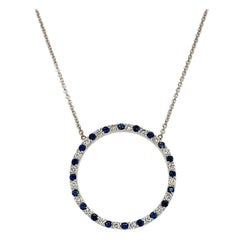 Blue Sapphire and Diamond Round Pendant Necklace