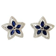 Blue Sapphire and Diamond Star Stud Earrings in 18 Karat White Gold