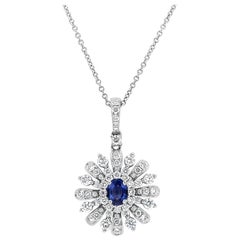 Blue Sapphire and Diamond Sunburst Pendant Necklace