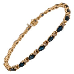 Blue Sapphire and Diamond Tennis Bracelet in 14K Yellow Gold, Five Star Jewelry