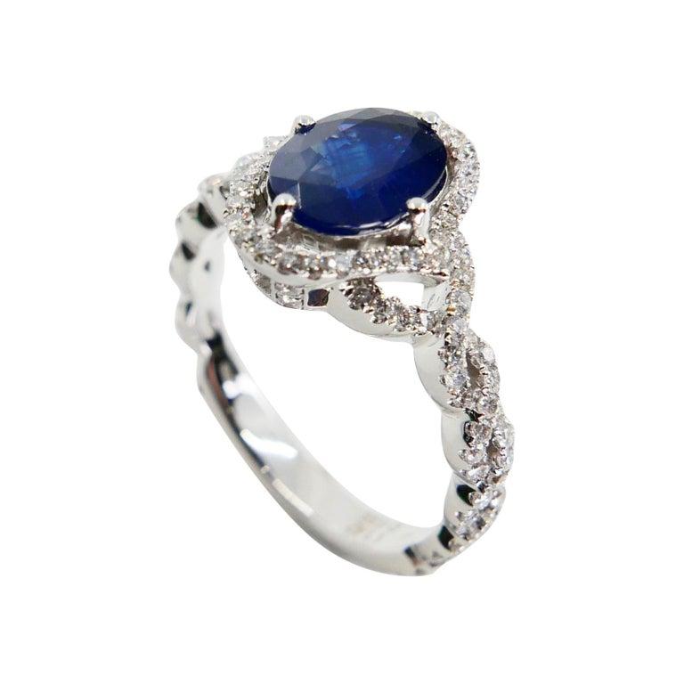 Blue Sapphire and Diamond Twist Ring, 18 Karat White Gold For Sale