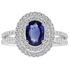 Blue Sapphire and Diamonds Double Halo Engagement Ring in 18 Karat White Gold
