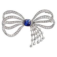 Blue Sapphire and Old Mine Cut Diamond Platinum Bow Spray Brooch, circa 1930s