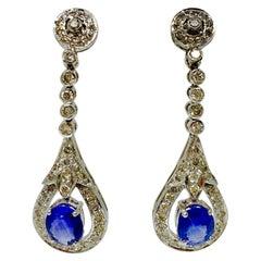 Blue Sapphire and White Diamond Dangle Earrings in 14 Karat Gold