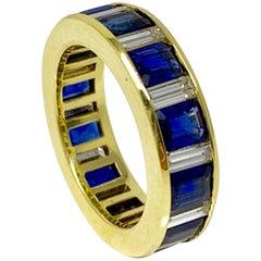Blue Sapphire and White Diamond Wedding Band in 18 Karat Yellow Gold
