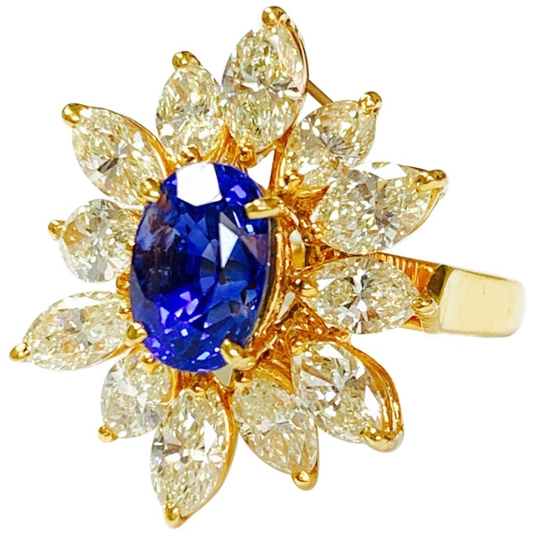 Blue Sapphire and Yellow Diamond Ring in 18 Karat Yellow Gold For Sale
