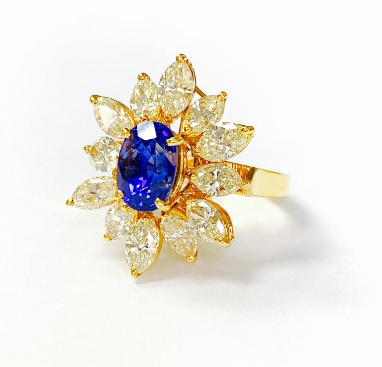 Moguldiam Inc's oval blue sapphire and yellow marquise diamond ring in 18 k yellow gold is beautifully handmade.  The details are as follows :  Blue sapphire weight: 3.18 carat  Yellow diamond weight: 3.38 carat  Gold weight : 6.69 grams  Ring size